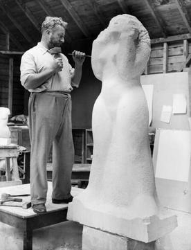 Gibbings at work in his studio in 1933
