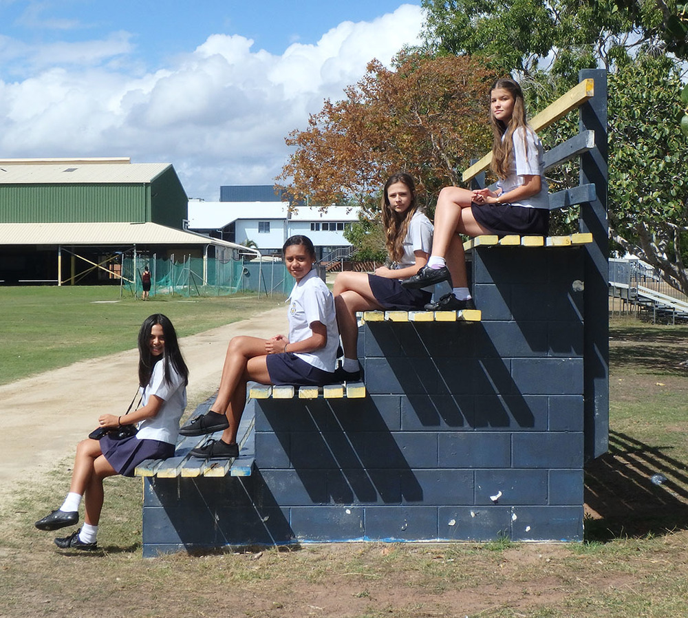 Bowen State High School students (com)posed on the school grounds.