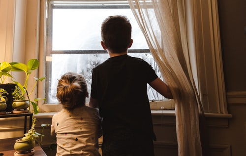 boy and girl looking out of window.jpg