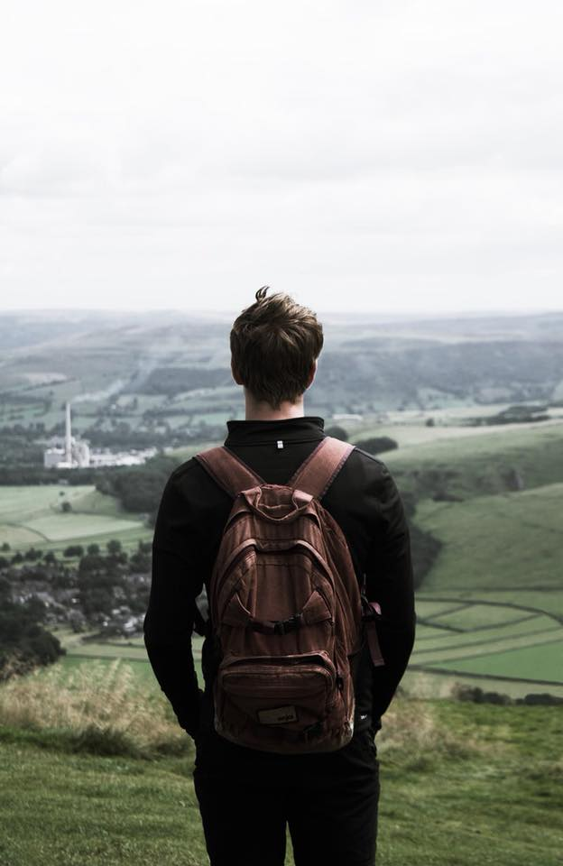 boy with backpack overlooking ridge.jpg
