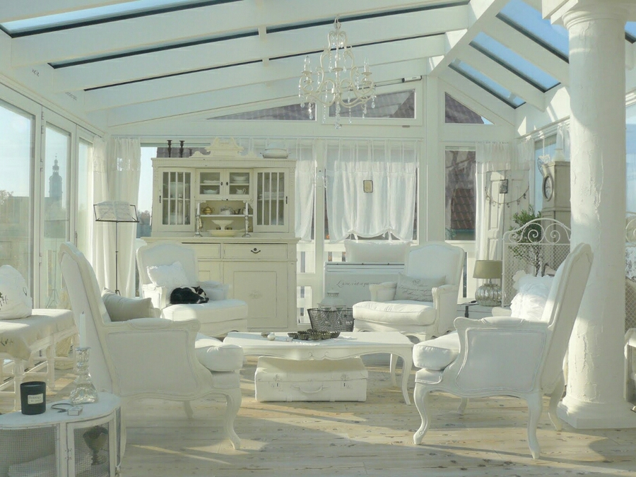 Shobby chic living space in an all glass solarium.