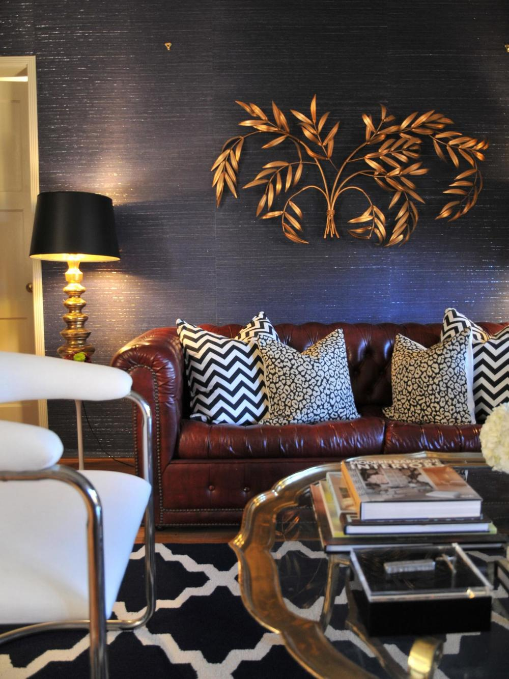Design by: Jordan Capella Burgundy, navy, and gold living room design