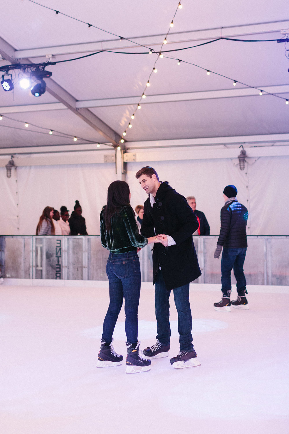 atlanta_proposal_photographer_ice_skating_rooftop_ponce_city_surprise_jewish_couple_1090.jpg