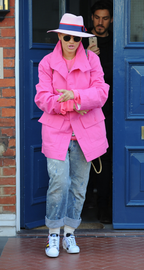Rita Ora seen wearing a pink jacket as she goes out and about in London