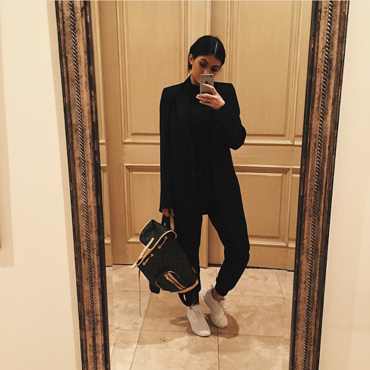 c6ce451663b Kylie Jenner was fully clothed from head-to-toe sporting a mean  jumpsuit blazer combo and a pair of all white Nike Air Max Theas.