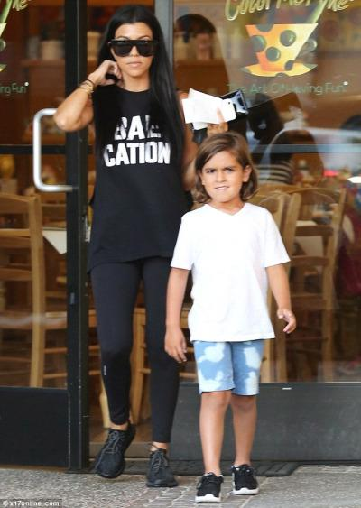 Kourtney Kardashian and her little Disick skewed casual running errands in LA. We were loving this   Departure Baecation Low Armhole Muscle Tank   and  her   adidas Yeezy 350 Boost Sneakers  .