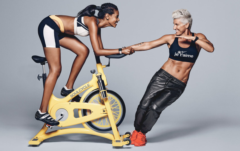 Top model Grace Mahary (left), shown with Griffith, is a SoulCycle regular. Top, on Mahary: Sports bra, VPL, $44; VPLNYC.com. Shorts, 9 2 5 Fit, $58; 9Two5Fit.com. Briefs, $75; BeachRiot.com. Hair band, $28; Jakimac.com. Earrings, $250; AlyssaNorton.com. Watch, $749; Apple.com. Shoes, Shimano, $100; Bike.Shimano.com. Socks, $14; Tracksmith.com. Water bottle, $33;KleanKanteen.com. On Griffith: Sports bra; SoulCycle.com for similar styles. Pants; Athleta.com for similar styles. Hoop earrings, $130;VenusByMariaTash.com. Safety pin earrings, Bing Bang, $48; BingBangNYC.com. Watch, $649; Apple.com. Sneakers, $190; Nike.com