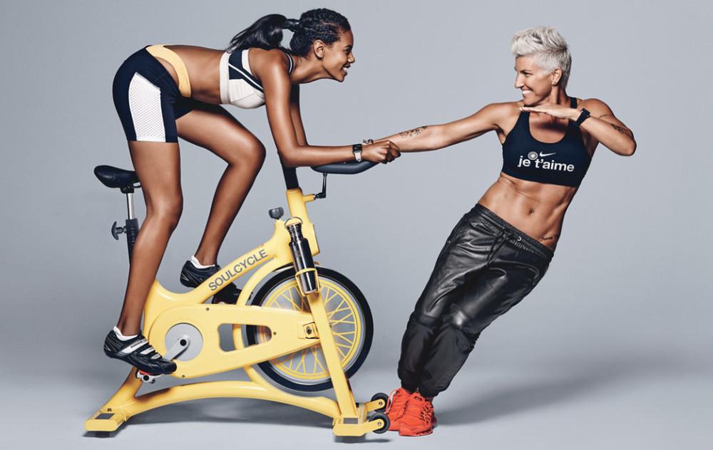 Top model Grace Mahary (left), shown with Griffith, is a SoulCycle regular. Top, on Mahary: Sports bra, VPL, $44;VPLNYC.com. Shorts, 9 2 5 Fit, $58;9Two5Fit.com. Briefs, $75;BeachRiot.com. Hair band, $28;Jakimac.com. Earrings, $250;AlyssaNorton.com. Watch, $749;Apple.com. Shoes, Shimano, $100;Bike.Shimano.com. Socks, $14;Tracksmith.com. Water bottle, $33;KleanKanteen.com. On Griffith: Sports bra;SoulCycle.comfor similar styles. Pants;Athleta.comfor similar styles. Hoop earrings, $130;VenusByMariaTash.com. Safety pin earrings, Bing Bang, $48;BingBangNYC.com. Watch, $649;Apple.com. Sneakers, $190;Nike.com