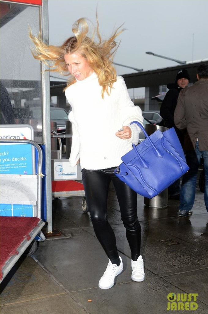 Gwyneth Paltrow kept her cute as she battled the wind wearing   adidas x Raf Simons Stan Smith Leather Sneakers.