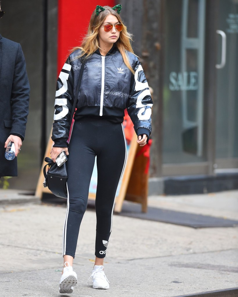 Gigi Hadid was the cat's meow in NYC over the weekend. Before morphing into Sandy from 'Grease', the model paired didas Originals 3 Stripe Leggings with Nike Air Huarache PRM sneaks, an adidas Mystic Moon Crop Track Jacket, and a Flower Children Only Meow Crown Green.