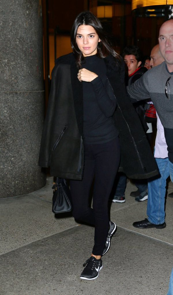Kendall Jenner wearing Nike Free 4.0 Flyknit Sneakers in Black/Wolf Grey/Dark Grey/White, Hermes Birkin Bag, L'Agence the Chantal Low Rise Skinny Jeans in Noir and Yeezy Oversized Shearling Coat