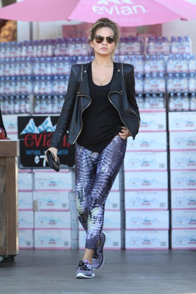 Chrissy Teigen ran some errands looking cute and casual in Nike  Flyknit Lunar 3 Sneakers in Fuchsia
