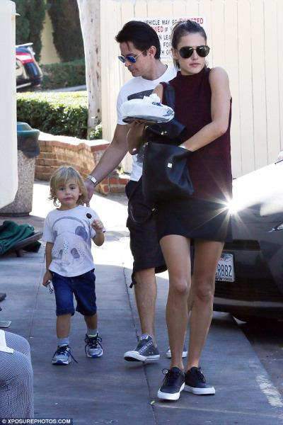 Alessandra Ambrosio wearing a French Connection Hendy Mixed Media Tiered Shift Dress and Vans PRM Leather Era sneaks.