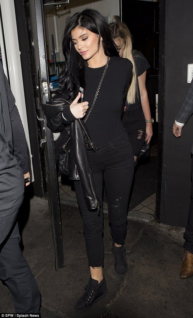 Kylie Jenner headed out in all black wearing J Brand 835 Mid-Rise Capri Jeans in Exposure and Vans Sk8-Hi Slim Zip Black Sneakers