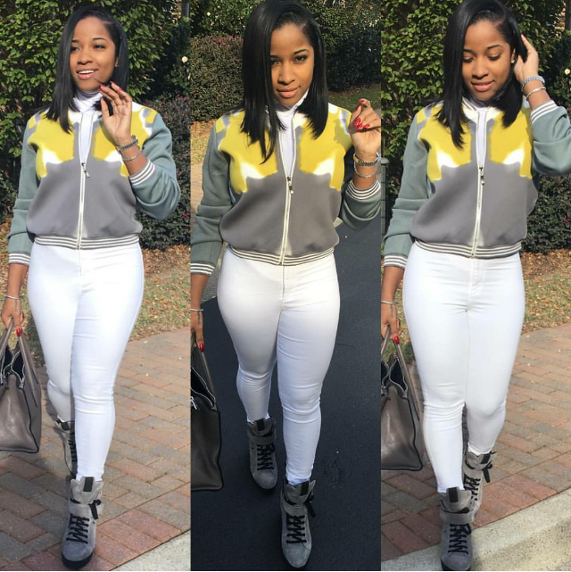 Toya Wright matched colorful grays and winter whites with grey and black high-top trainers.