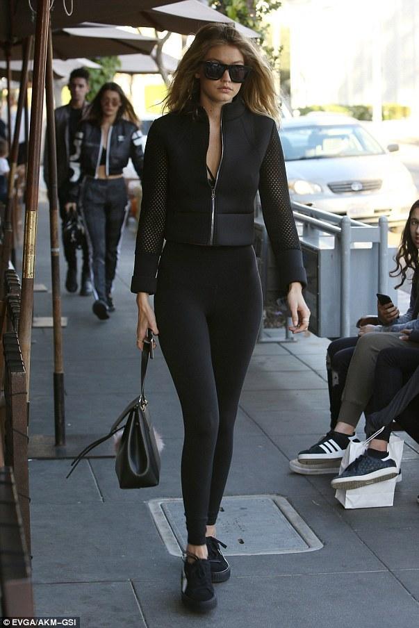 More 'Creeper' sightings! Gigi Hadid headed to lunch in LA wearing the coveted Riri sneaks and Alo Yoga Airbrush Leggings.