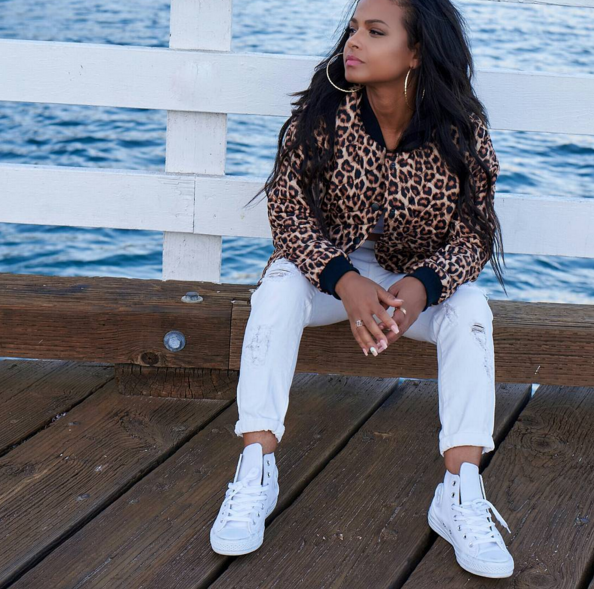 Christina Milian celebrated the release of her latest project in a fresh pair of all white Converse Classics.