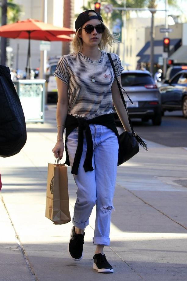 Emma Roberts keep it simple in Los Angeles in Supra Noiz Sneakers and an Adidas Chicago Bulls Black/Red Two Tone Snapback Cap.