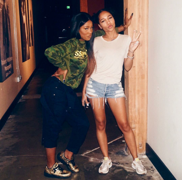 Keke Palmer and her homegirl posted up in Puma x Vashtie R698 metallic sneakers and Nike Air Huaraches.