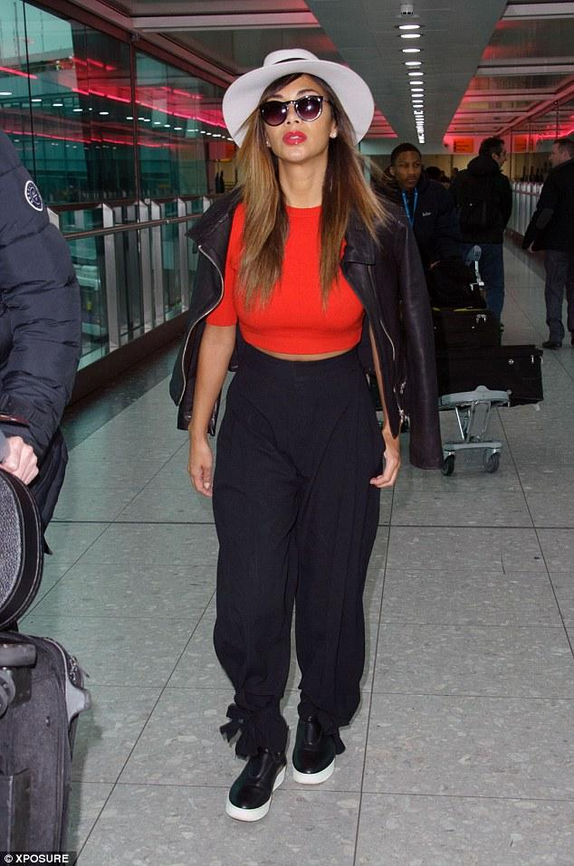 Nicole Scherzinger spotted in LAX wearing a Maison Michel Andre Fedora Hat a leather slip on sneaks.
