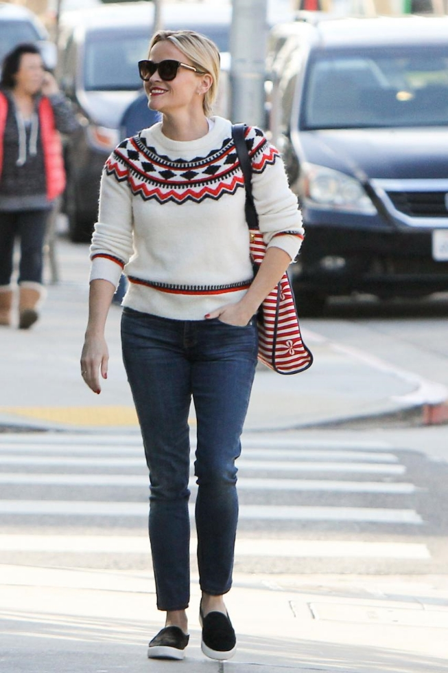 Reese Witherspoon was spotted bringing the holiday chic in a Draper James Fontaine Fairisle Sweater and Vince Blair 12 Calf-Hair Skate Sneakers.