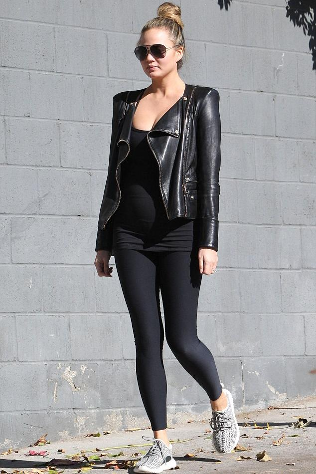 Chrissy Teigen pounded the pavement in a Jitrois Biker Jacket and Adidas Yeezy 350 Boost Sneakers.