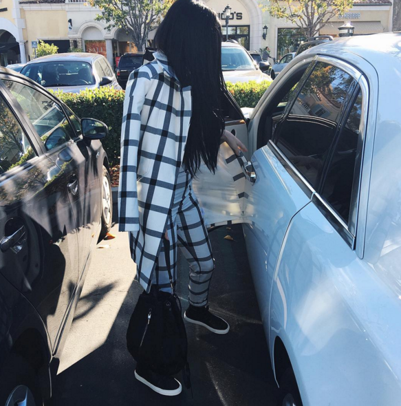 Another day, another Kylie Jenner sneaker style moment. The reality star was spotted in Stylestalker separates and black high tops.
