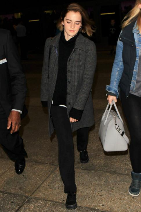 Emma Watson kept it cozy in Vans Authentic Sneakers and an Isabel Marant Karine Turtleneck Sweater.