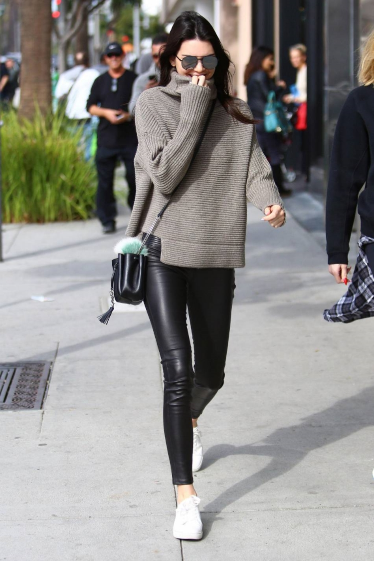 Kendall Jenner, sneaker style spirit animal, took to Beverly Hills in  her favorite Kenneth Cole Kam Sneakers, a 1-01 Babaton For Aritzia Mika Turtleneck Sweater in Heather Amie Copy and leather leggings.