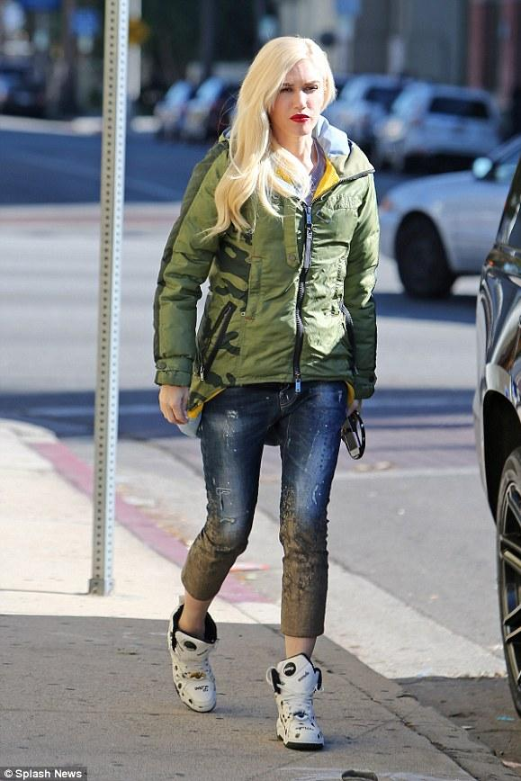 Gwen Stefani did some holiday shopping wearing Dsquared2 Mud Print Crop  Jeans , a L.A.M.B. x Burton Oc Insulator Parka, and  Melody Ehsani x Reebok Black Top Pumps.