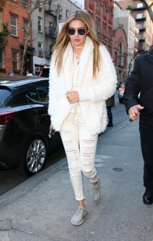 Gigi Hadid wearing adidas Yeezy 350 Boost Sneakersin Moonrock