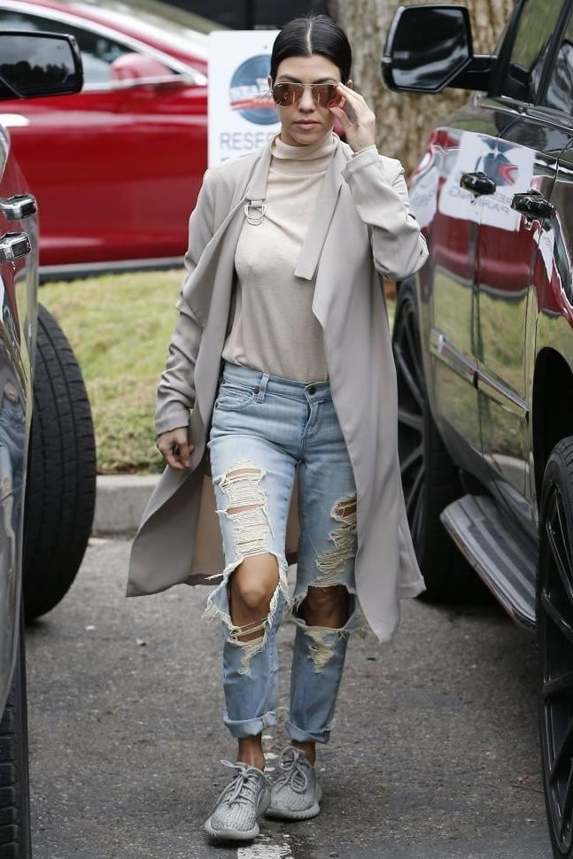 Kourtney Kardashian brought some sneaker style slayage in Citizens of Humanity Avedon Slick Skinny Jeans in Comet and Yeezy 350 Boost Sneakers in Moonrock.