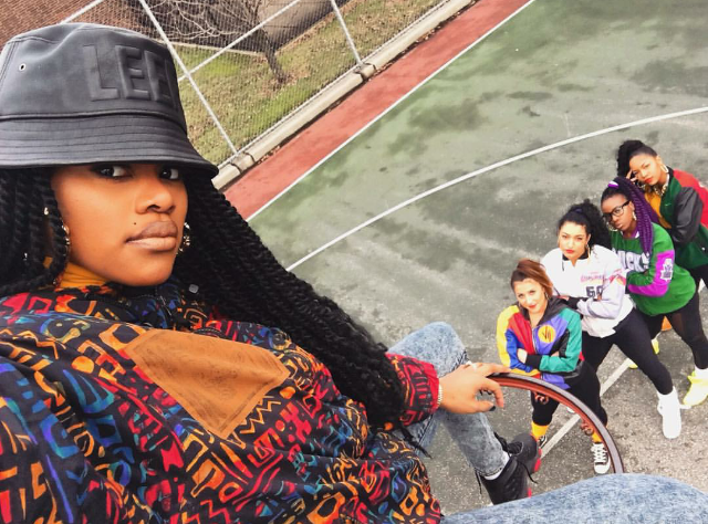 "New mommy Teyana Taylor was back to work in all of her round the way girl glory! The singer took to the rim in a pair of Air Jordan 14 Retro ""Dirty Bred"" sneaks for a perfect shot with her posse. LOVE."