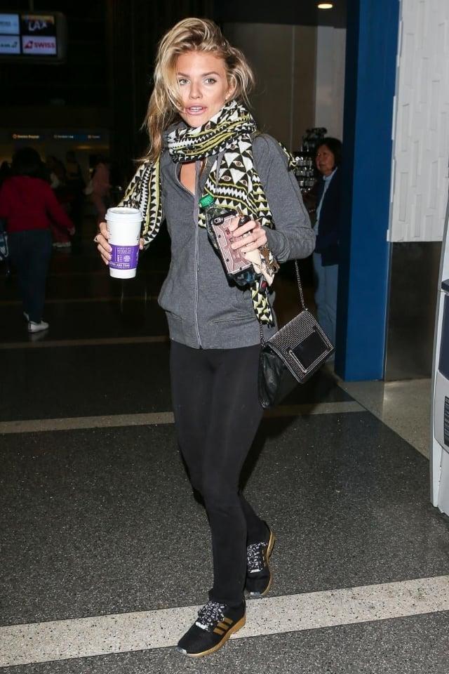 90210 alum Annalynn McCord was busy nabbing caffeine at LAX in a pair of  adidas ZX Flux in black/gold.