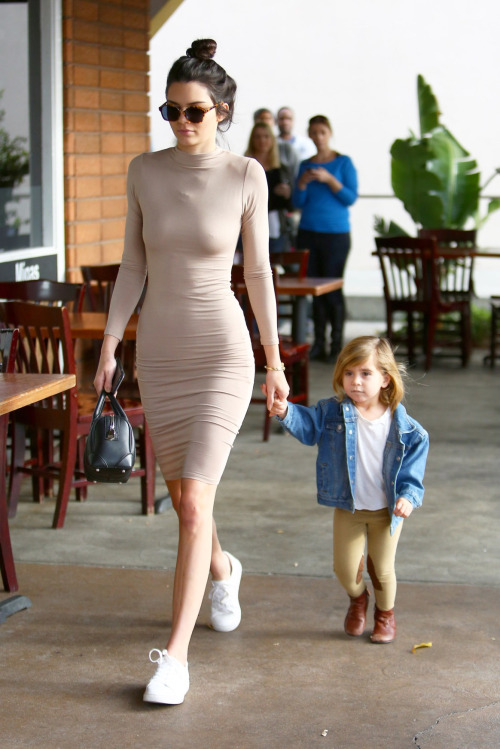 Why hello again Ms. Jenner! Kendall walked her way to the top of today's gallery during a weekend family day in Sherman Oaks. The model strutted in adidas Stan Smith sneaks and a NW Midi dress by Naked Wardrobe.