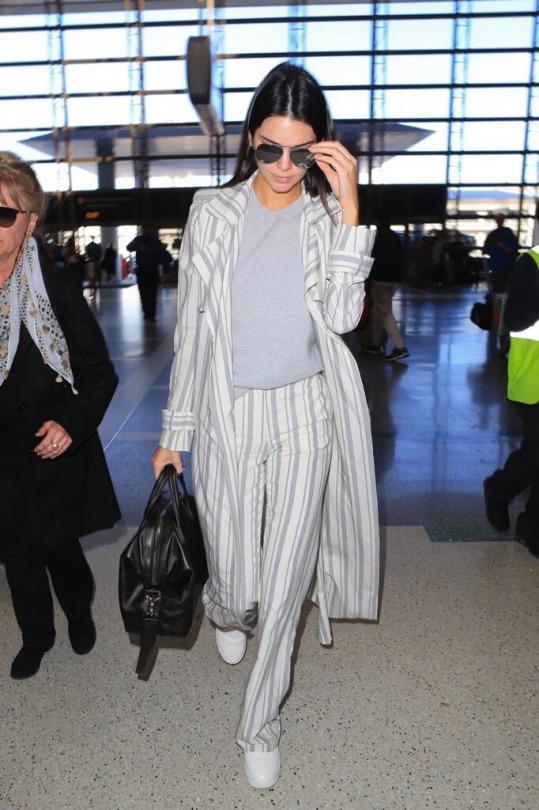 Kendall Jenner took flight in Celine Sneaker Pull on in Optic White.