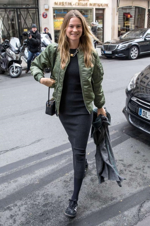 Behati Prinsloo avoided the New York blizzard with a trip to Paris for Men's Fashion Week. The model was spotted wearing Adidas Samba Classic Sneakers, a Theory Adrellana Ribbed Wool-Blend Maxi Dress and Alpha Industries Ma-1 Flight Nylon Reversible Bomber Jacket in Sage.