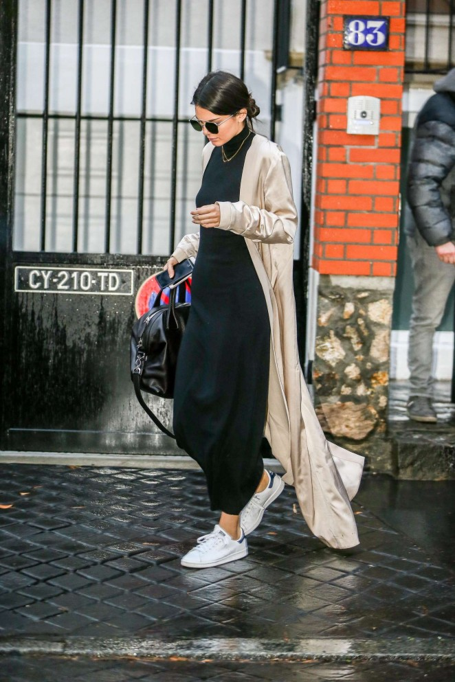Kendall Jenner is constantly so nice that she makes our gallery it twice.  This time she was spotted out and about in Paris in a floor-grazing   duster  , midi-length LBD, and   adidas     Stan Smith kicks.