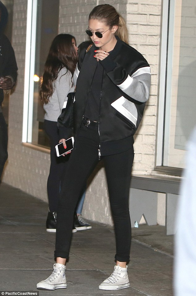 Gigi Hadid was spotted in LA fresh from a mani wearing Converse Chuck Taylor All Star Core Hi Sneakers in Optical White and a Neil Barrett Interfacing Arrow Bonded Jersey Bomber Jacket.