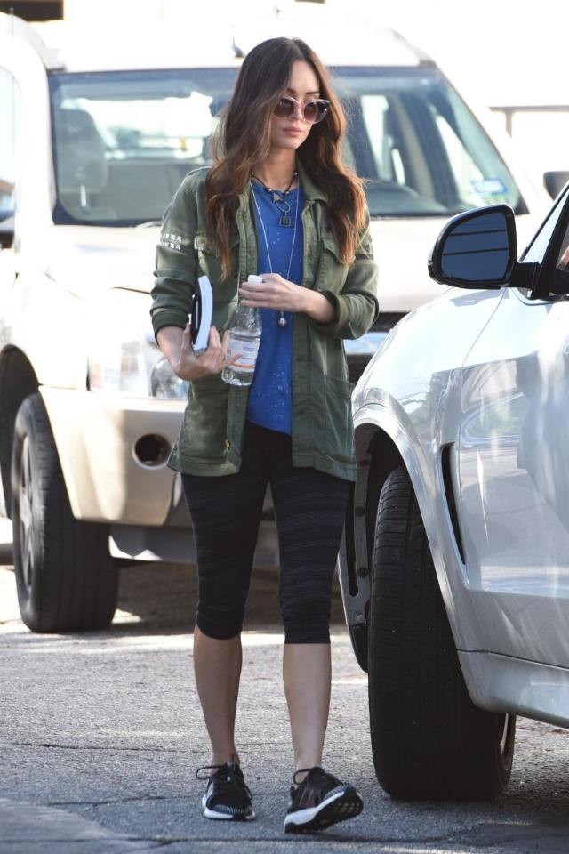 Megan Fox pounded the pavement wearing a Mother Cargo Jacket in Military Green and adidas x Stella McCartney Ultra Boost Sneakers.