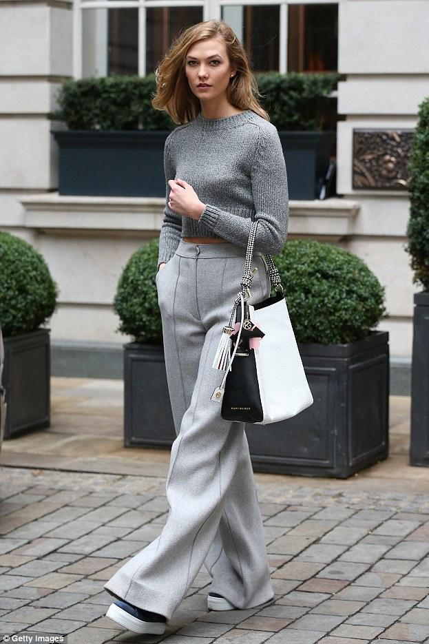 YES. KARLIE. Karlie Kloss gave us life in Kurt Geiger London Ladbrook Navy Croc Sneakers, Amanda Wakeley Ito Grey Wool Pants and an Elisabetta Franchi Cropped Sweater. W-e-r-k.