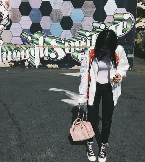 Kylie Jenner kept it cute for some artistic snaps wearing Comme des Garcons Play Chuck Taylor High-Top Sneakers.