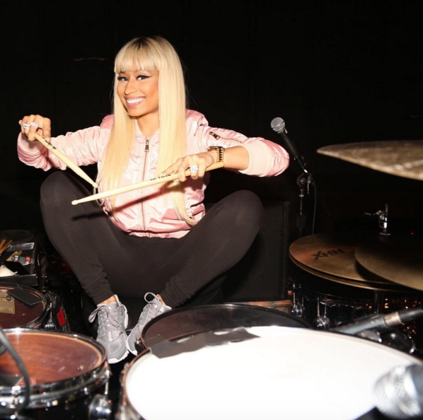 We haven't seen Nicki in a minute! The rapper resurfaced as she readied for tour with her drumsticks and a pair of grey Nike Air Huaraches.