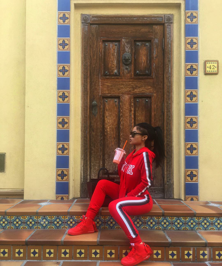 India Love kept it cute in a VS track suit and custom NikeiD blood red AF1s.  You like?