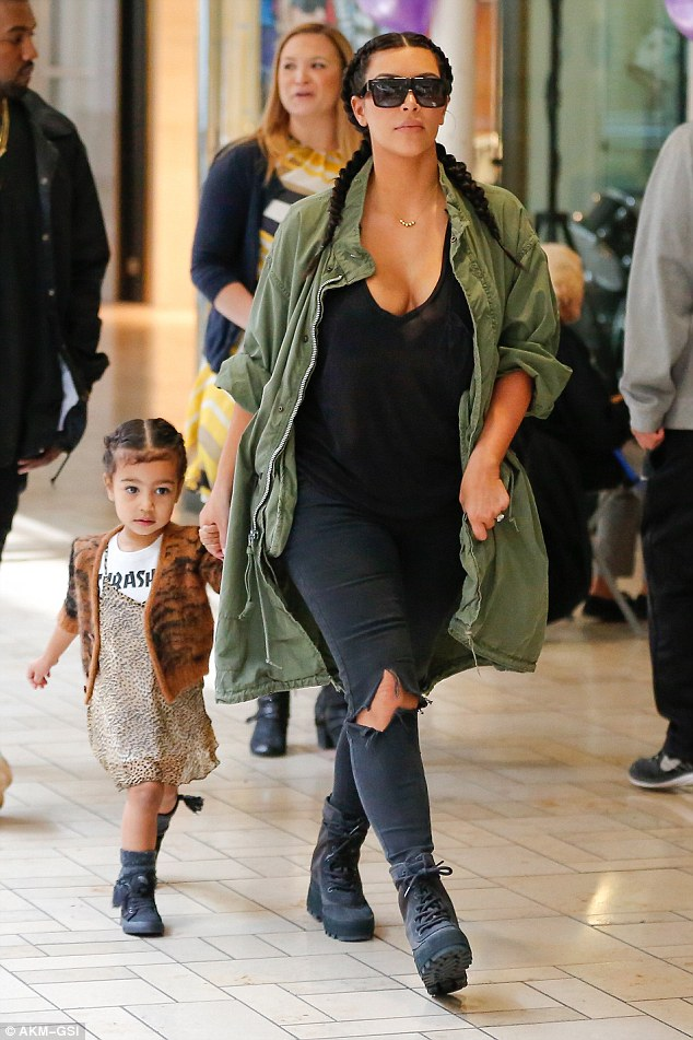 We're not huge fans of the Yeezy 950 boot, but Kim Kardashian made them look amazing as she, North, and hubby Kanye made a trek to the mall for some Build-A-Bear fun.  Very cute.