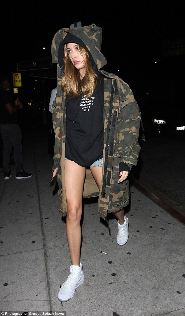 Hailey Baldwin hit LA streets wearing Nike Air Force 1 Ultra Flyknit Sneakers in White/White/Pure Platinum, Justin Bieber Purpose World Tour Hooded Sweatshirt and Faith Connexion Camo Hooded Parka.