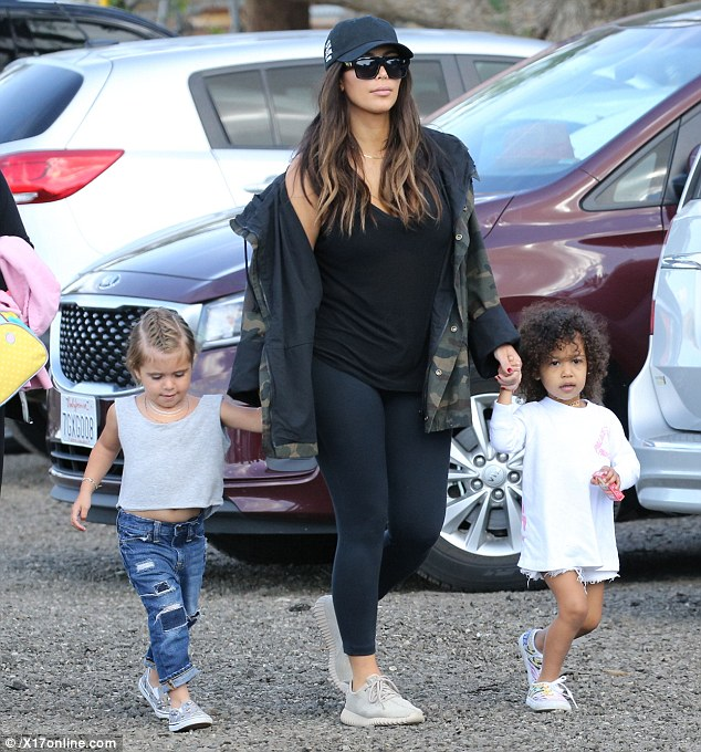 Kim Kardashian was up for an Easter egg hunt with the girls wearing a T by Alexander Wang Classic Mini Pocket Tank, Celine Cl 41756s Zz Top Sunglasses, Lululemon Align Pants in Black, Anti Social Social Club Weird Cap in Black, Yeezy Camouflage Coat and Adidas Yeezy 350 Boost Sneakers in Moonrock.