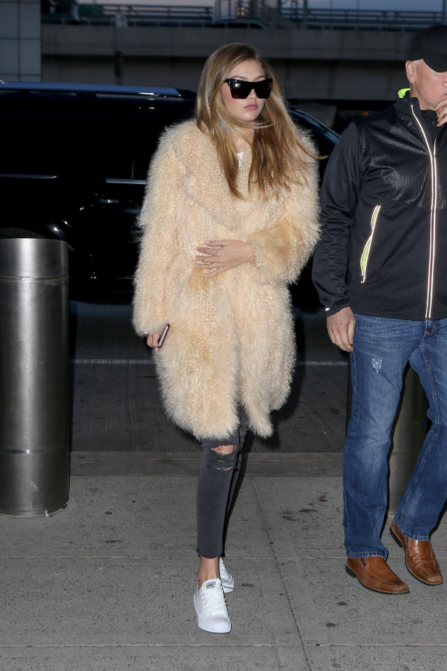 Gigi Hadid  has a thing for outer wear  these days.  The model was spotted wearing Elizabeth and James Wythe Sunglasses, a furry Elizabeth and James Hart Coat and Converse Chuck Taylor All Star II Low Top Sneakers.
