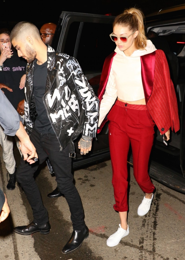 Gigi Hadid strolled hand-in-hand with boyfriend Zayn Malik as the two made an appearance at his album listening party over the weekend.  Gigi made a colorful splash in adidas Superstar sneakers, a red pantsuit and Komono Stella Pale Blush Sunglasses.