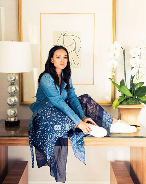 Karrueche Tran sat pretty in a snap from her shoot with The Coveteur in white trainers.